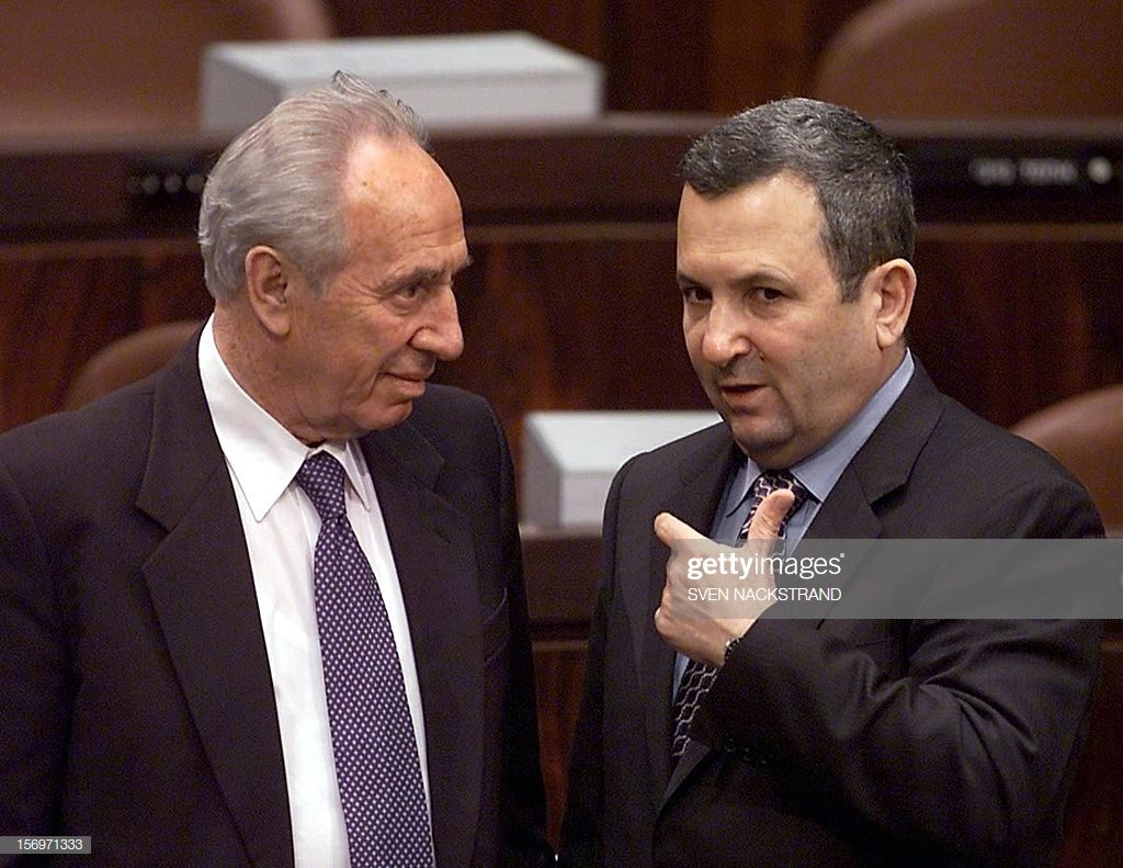 Israeli Prime Minister Ehud Barak (R) talks to Shimon Peres, Minister of Regional Planning, after Barak's speech at the opening session of parliament in Jerusalem 30 October 2000. AFP PHOTO / SVEN NACKSTRAND (Photo credit should read SVEN NACKSTRAND/AFP/Getty Images) Link to Getty Images